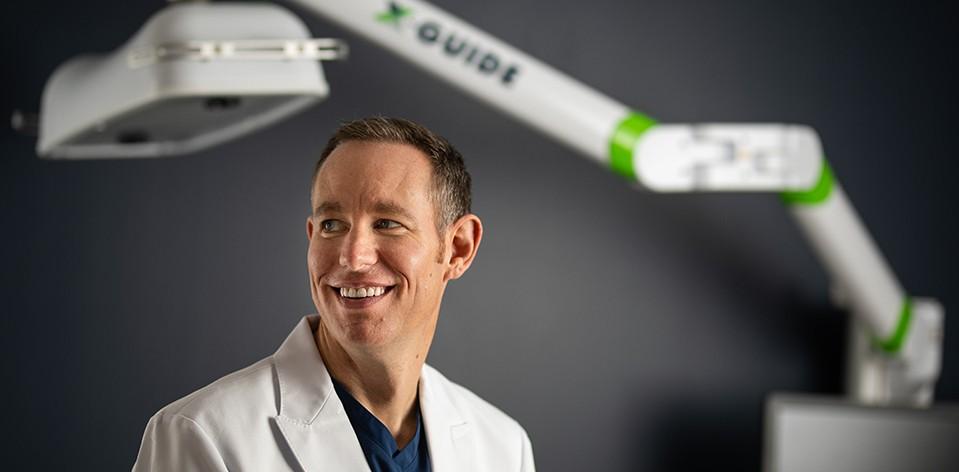 Dr. Clagett With X-nav Machine in Background