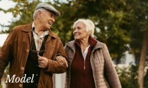 Smiling Older Couple Arm in Arm Outdoors