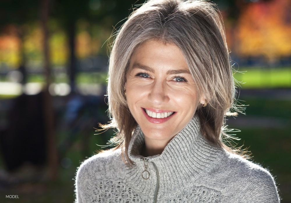 Older Female Showing Off Natural-Looking Smile